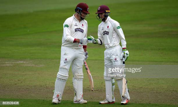 Marcus Trescothick and Eddie Byrom of Somerset embrace during Day One of the Specsavers County Championship Division One match between Somerset and...