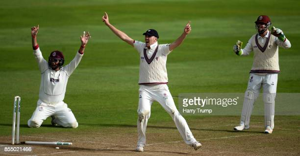 Marcus Trescothick Craig Overton and Steve Davies of Somerset appeal during Day Four of the Specsavers County Championship Division One match between...