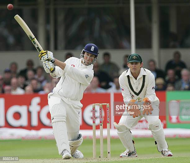 Marcus Trescothick of England hits a six off the bowling of Shane Warne of Australia with Adam Gilchrist of Australia looking on during day one of...