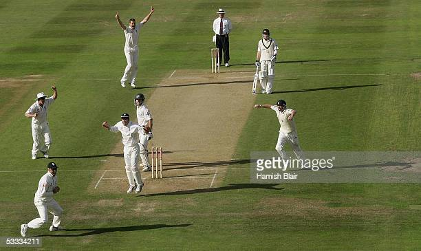 Marcus Trescothick of England takes a catch off the bowling of team mate Ashley Giles to dismiss Simon Katich of Australia during day three of the...