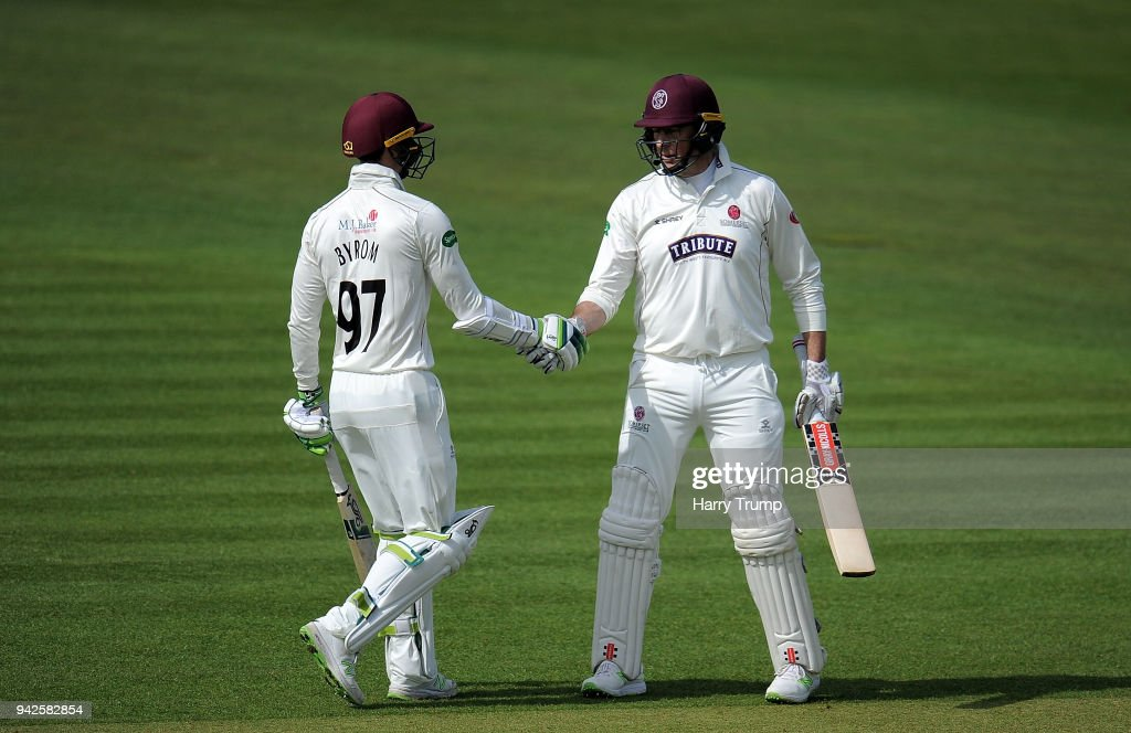 Marcus Trescothick of Somerset(R) celebrates his half century with Eddie Byrom of Somerset(L) during Day One of the Friendly match between Somerset and Ireland at The Cooper Associates County Ground on April 6, 2018 in Taunton, England.