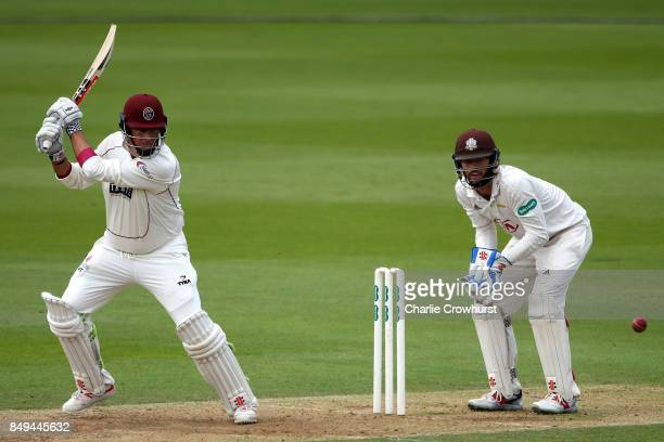 Marcus Trescothick of Somerset hits out while Surrey keeper Ben Foakes looks on during day one of the Specsavers County Championship Division One...