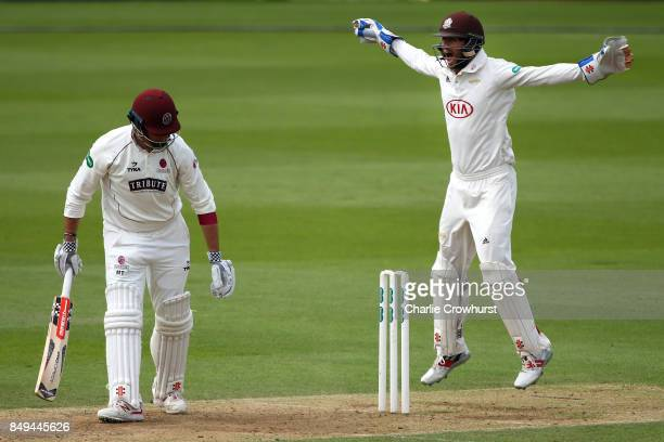 Marcus Trescothick of Somerset is dismissed for lbw while Surrey keeper Ben Foakes appeals during day one of the Specsavers County Championship...