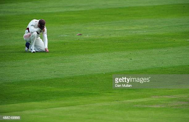Marcus Trescothick of Somerset kneels and looks dejected after dropping a catch during day two of the LV County Championship Division One match...