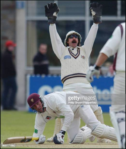 Marcus Trescothick of Somerset picks himself up as Gloucestershire wicketkeeper Jack Russell appeals for an LBW decision during the Benson and Hedges...