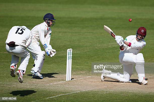 Marcus Trescothick of Somerset pulls a shot to the legside as Steven Croft of Lancashire takes evasive action during day four of the Specsavers...