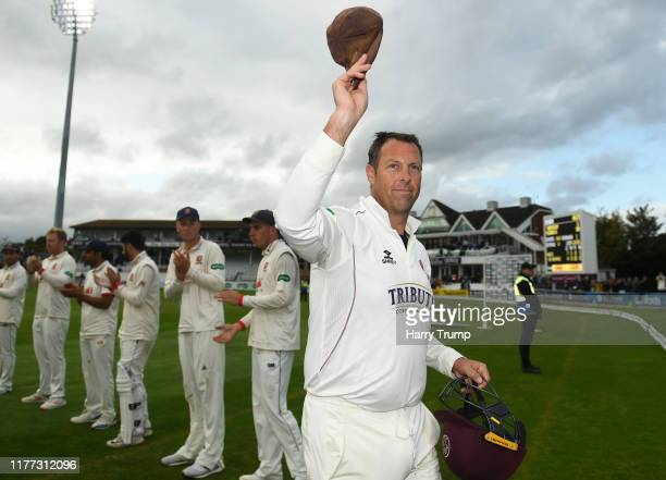 Marcus Trescothick of Somerset raises his cap to the crowd as he is given a guard of honour on his final match before retiring during Day Four of the...
