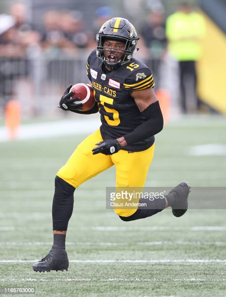 Marcus Tucker of the Hamilton Tiger-Cats takes off on a long reception against the Toronto Argonauts during the annual Labour Day Classic at Tim...