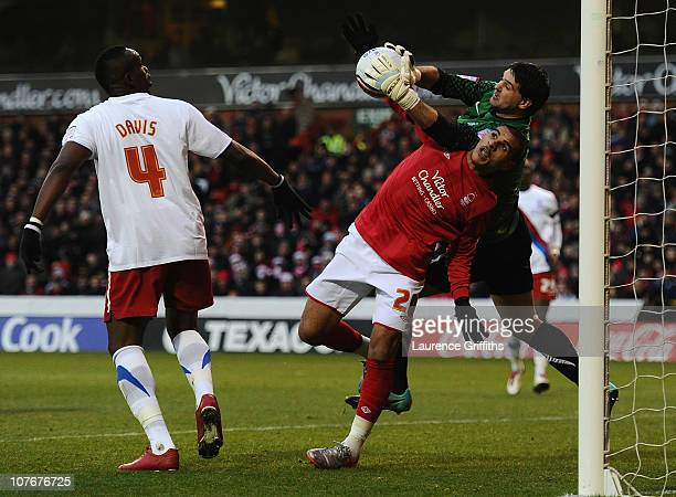Marcus Tudgay of Nottingham Forest battles with Julian Speroni of Crystal Palace during the npower Championship match between Nottingham Forest and...