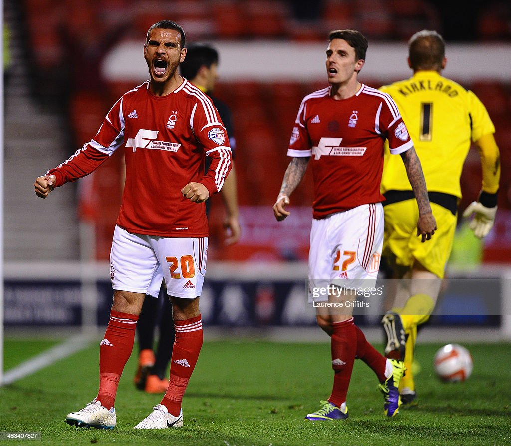 Marcus Tudgay of Nottingham Forest celebrates scoring the second goal in front of Matt Derbyshire during the Sky Bet Championship match between Nottingham Forest and Sheffield Wednesday at City Ground on April 8, 2014 in Nottingham, England.