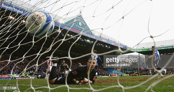 Marcus Tudgay of Sheffield Wednesday scores past Paddy Kenny of Sheffield United during the Coca Cola Championship match between Sheffield Wednesday...