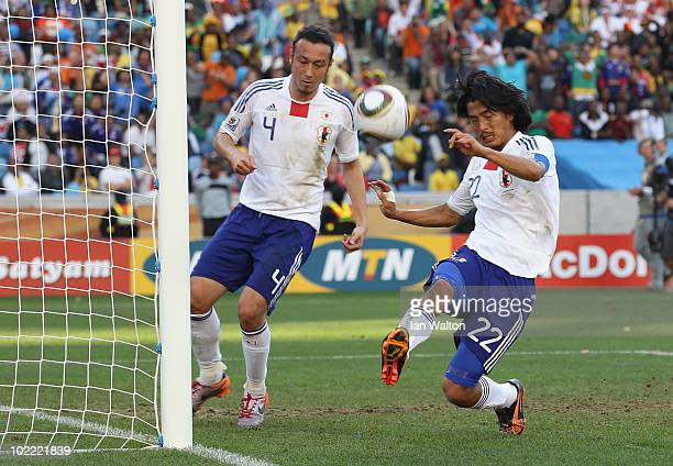 Marcus Tulio Tanaka and Yuji Nakazawa of Japan clear the ball from the goal mouth during the 2010 FIFA World Cup South Africa Group E match between...