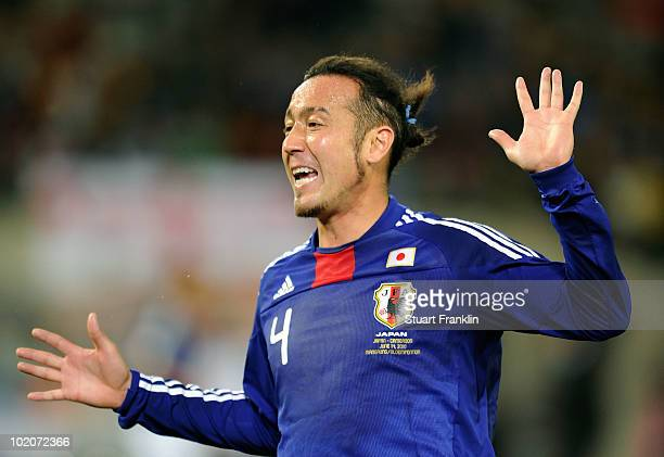 Marcus Tulio Tanaka of Japan celebrates during the 2010 FIFA World Cup South Africa Group E match between Japan and Cameroon at the Free State...