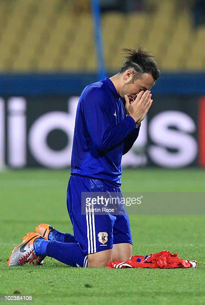 Marcus Tulio Tanaka of Japan celebrates victory by praying after knocking Denmark out of the competition during the 2010 FIFA World Cup South Africa...
