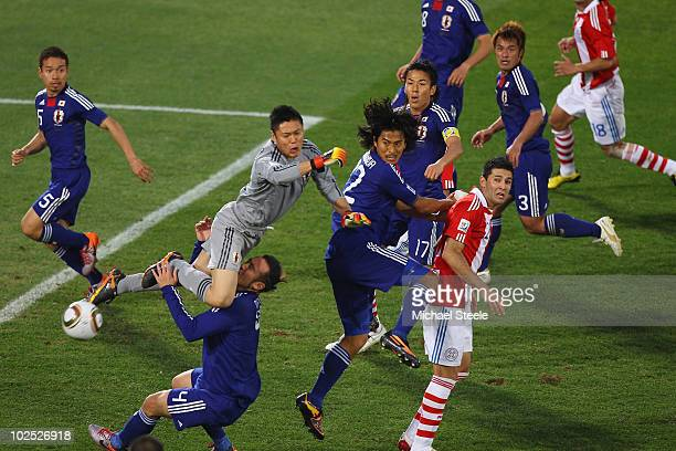 Marcus Tulio Tanaka of Japan collides with his goalkeeper Eiji Kawashima during the 2010 FIFA World Cup South Africa Round of Sixteen match between...