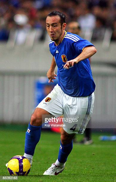 Marcus Tulio Tanaka of Japan controls the ball during the 2010 FIFA World Cup qualifier match between Japan and Uzbekistan at Saitama Stadium on...
