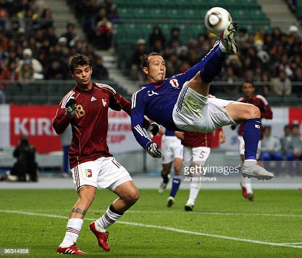 Marcus Tulio Tanaka of Japan fights for the ball during Kirin Challenge Cup Soccer match between Japan and Venezuela at Kyushu Sekiyu Dome on...