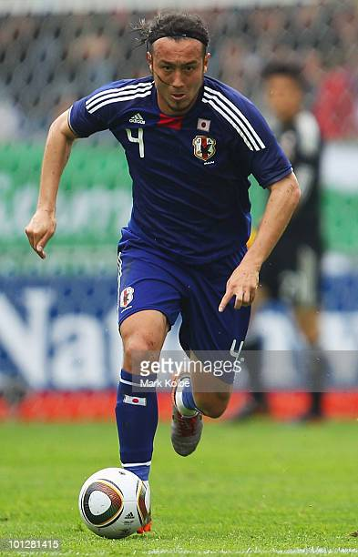 Marcus Tulio Tanaka of Japan runs the ball forward during the International Friendly between Japan and England at UPCArena on May 30 2010 in Graz...