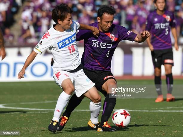 Marcus Tulio Tanaka of Kyoto Sanga and Asahi Yada of JEF United Chiba compete for the ball during the JLeague J2 match between Kyoto Sanga and KEF...