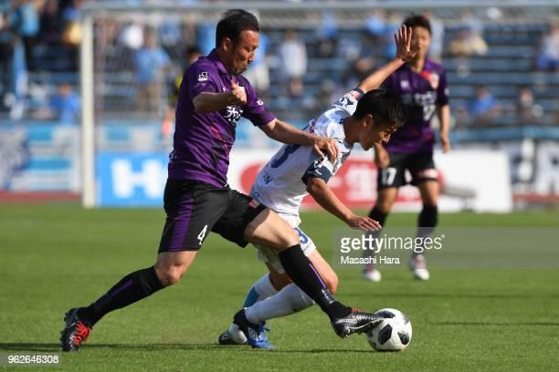 Marcus Tulio Tanaka of Kyoto Sanga and Bae Seung Jin of Yokohama FC compete for the ball during the JLeague J2 match between Kyoto Sanga and Yokohama...