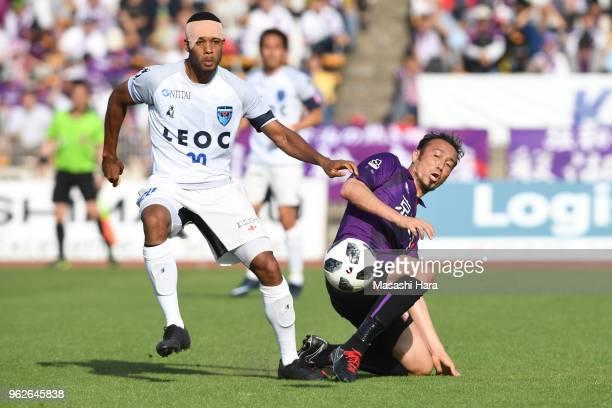 Marcus Tulio Tanaka of Kyoto Sanga and Calvin Jong A Pin of Yokohama FC compete for the ball during the JLeague J2 match between Kyoto Sanga and...