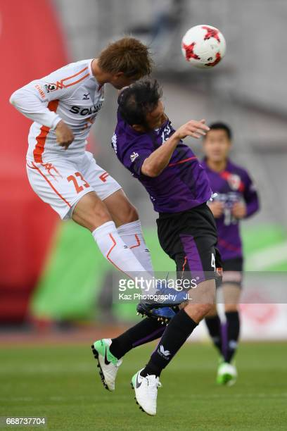 Marcus Tulio Tanaka of Kyoto Sanga and Makoto Rindo of Ehime FC compete for the ball during the JLeague J2 match between Kyoto Sanga and Ehime FC at...