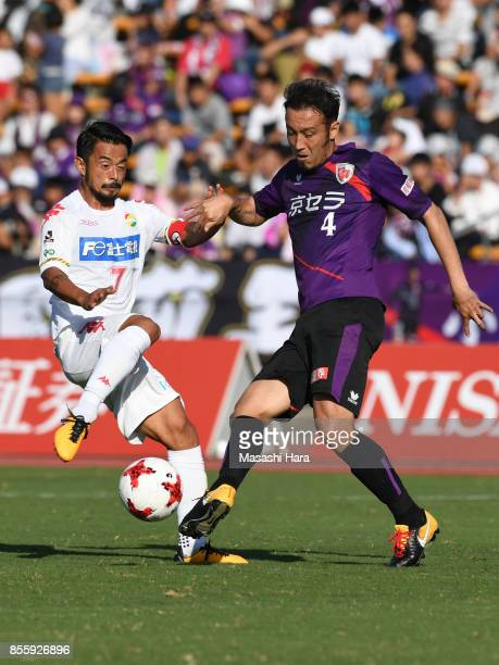 Marcus Tulio Tanaka of Kyoto Sanga and Yuto Sato of JEF United Chiba compete for the ball during the JLeague J2 match between Kyoto Sanga and KEF...