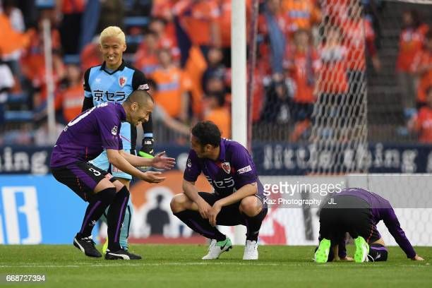 Marcus Tulio Tanaka of Kyoto Sanga is congratulated by Yosuke Ishibitsu and Takanori Sugeno after his side's 32 victory after the JLeague J2 match...