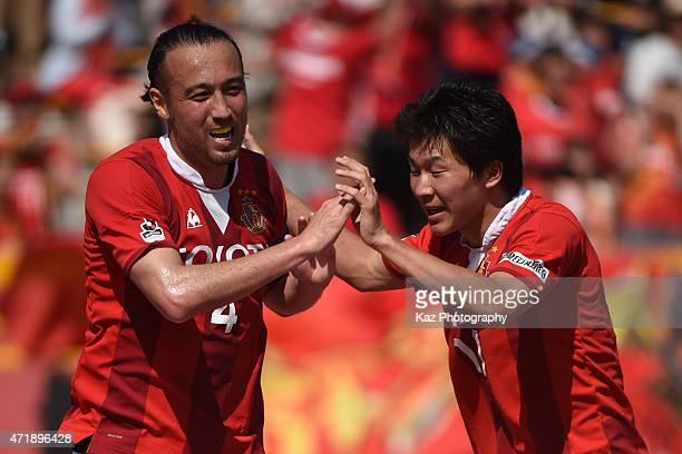 Marcus Tulio Tanaka of Nagoya Grampus celebrates 3rd goal with Kensuke Nagai of Nagoya Grampus during the J.League match between Nagoya Grampus and...
