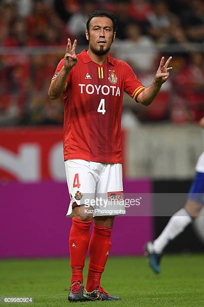 Marcus Tulio Tanaka of Nagoya Grampus instructs his team mates during the J League match between Nagoya Grampus and Gamba Osaka at the Toyota Stadium...