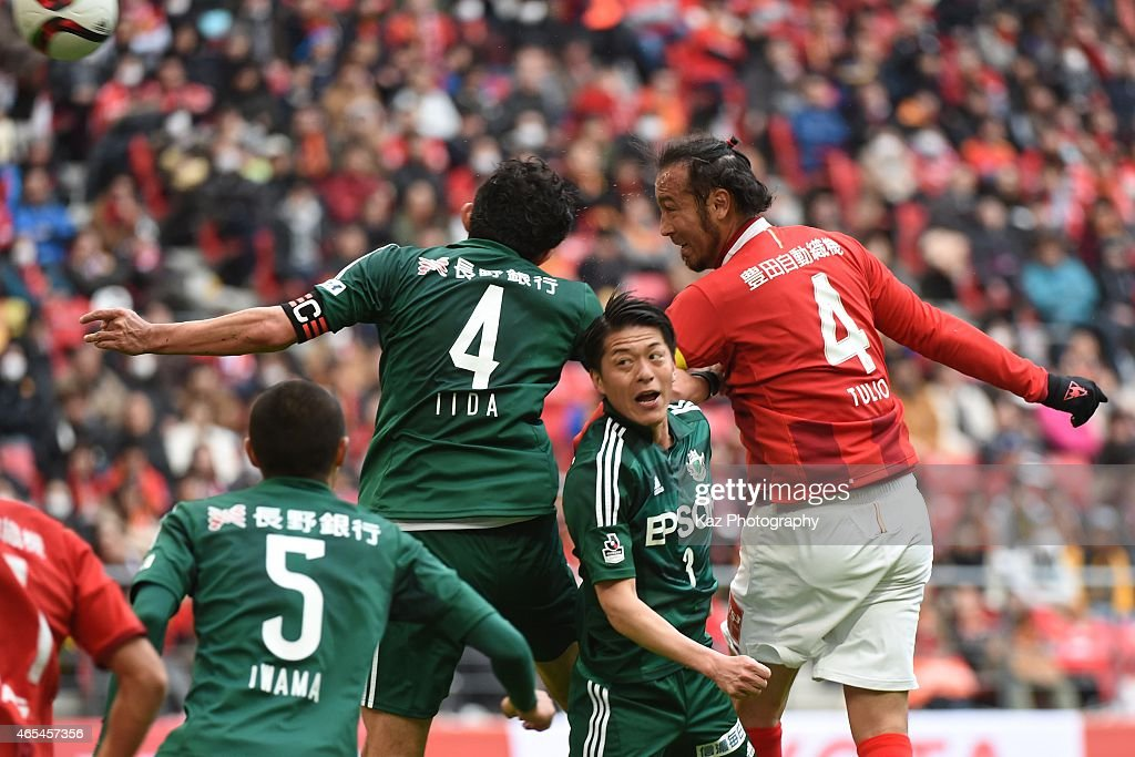Marcus Tulio Tanaka of Nagoya Grampus scores 2nd goal header during the J. League match between Nagoya Grampus and Matsumoto Yamaga at Toyota Stadium on March 7, 2015 in Toyota, Japan.