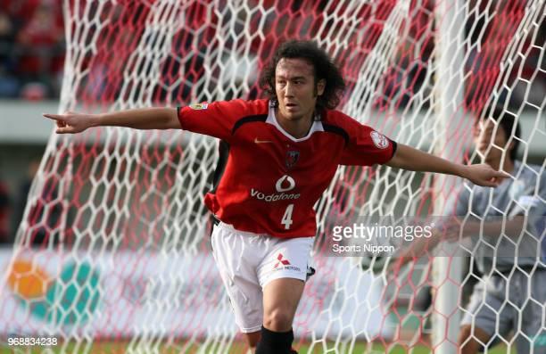 Marcus Tulio Tanaka of Urawa Red Diamonds celebrates scoring the opening goal during the JLeague Division 1 match between Urawa Red Diamonds and...