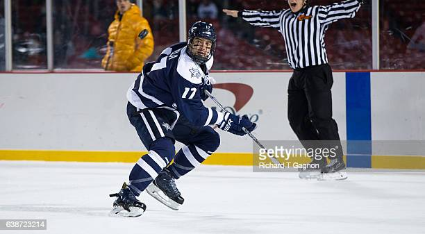 """Marcus Vela of the New Hampshire Wildcats skates against the Northeastern Huskies during NCAA hockey at Fenway Park during """"Frozen Fenway"""" on January..."""