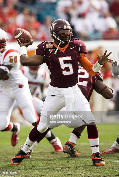 Marcus Vick of the Virginia Tech Hokies drops back to pass against the Louisville Cardinals during the Toyota Gator Bowl on January 2 2006 at Alltel...