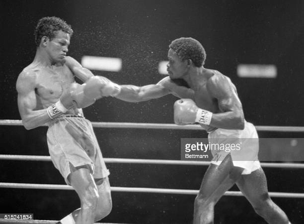 Marcus Villasana of Mexico backs away from a right thrown by Azumah Nelson of Ghana during WBC featherweight title match at the Forum Nelson went on...