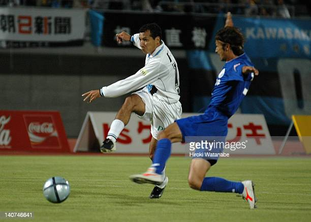 Marcus Vinicius de Morais of Kawasaki Frontale takes a shot while Naoki Mori of Mito Hollyhock tries to stop during the JLeague Second Division match...