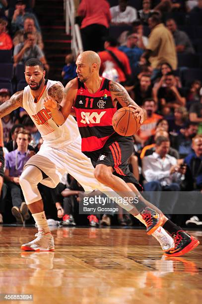 Marcus Vinicius 'Marquinhos' #11 of Flamengo drives against Markieff Morris of the Phoenix Suns during a preseason game on October 8 2014 at US...