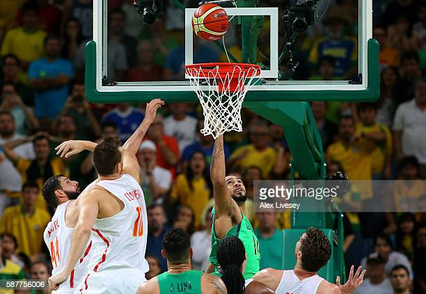 Marcus Vinicius Marquinhos of Brazil scores the winning basket against Victor Claver and Nikola Mirotic of Spain to win 6665 during a preliminary...