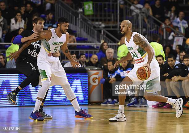 Marcus Vinicius of Brazil drives to the basket during a match between Argentina and Brazil as part of Four Nations Championship at Tecnopolis Stadium...