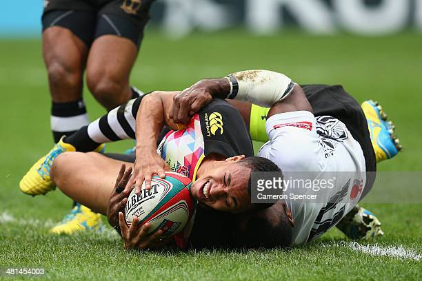 Marcus Watson of England scores a try during the Cup semifinal match between England and Fiji during the 2014 Hong Kong Sevens at Hong Kong...
