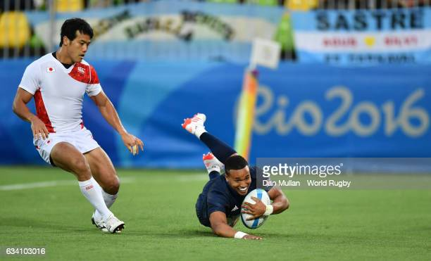 Marcus Watson of Great Britain dives over for a try during the Men's Rugby Sevens Pool C match between Great Britain and Japan on Day 4 of the Rio...