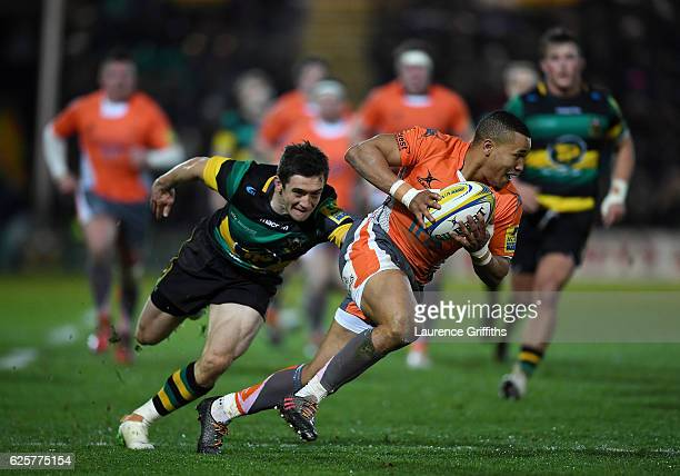 Marcus Watson of Newcastle Falcons breaks from Jamie Elliott of Northampton Saints during the Aviva Premiership match between Northampton Saints and...