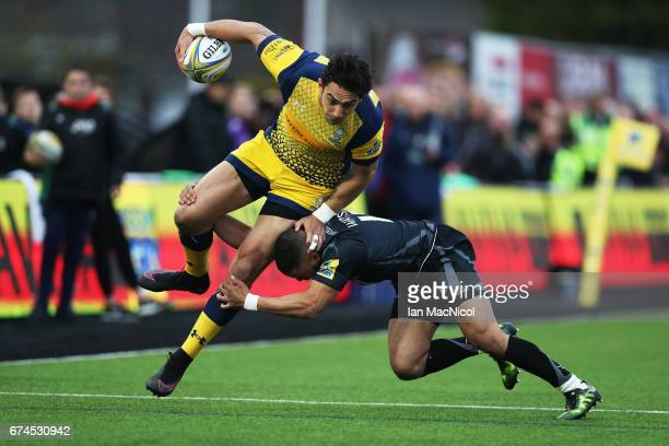 Marcus Watson of Newcastle Falcons tackles Bryce Heem of Worcester Warriors during the Aviva Premiership match between Newcastle Falcons and...
