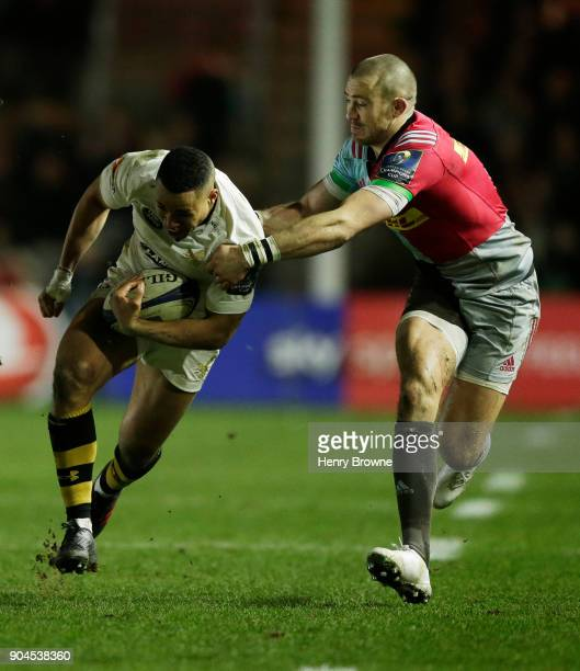 Marcus Watson of Wasps and Mike Brown of Harlequins during the European Rugby Champions Cup match between Harlequins and Wasps at Twickenham Stoop on...