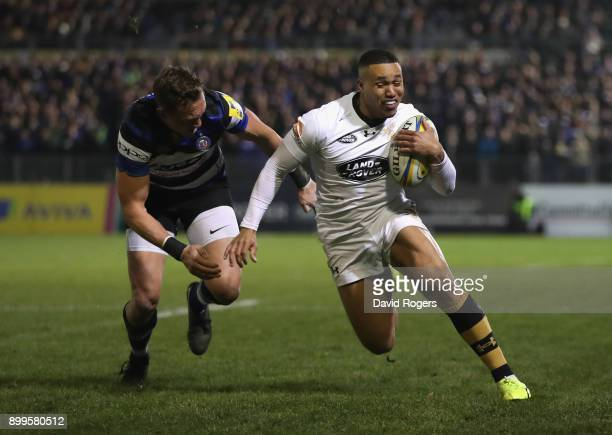 Marcus Watson of Wasps breaks clear of James Wilson during the Aviva Premiership match between Bath Rugby and Wasps at the Recreation Ground on...