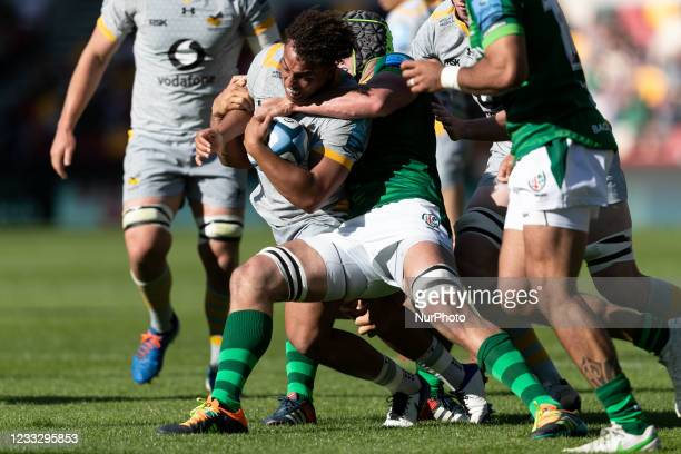 Marcus Watson of Wasps is tackled by Rob Simmons of London Irish during the Gallagher Premiership match between London Irish and Wasps at the...