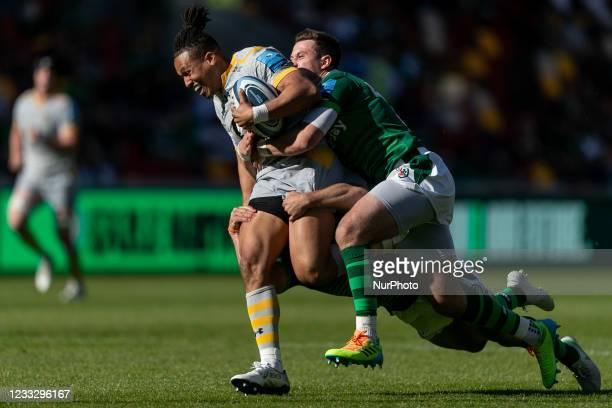 Marcus Watson of Wasps is tackled by Tom Parton and Nic Groom of London Irish during the Gallagher Premiership match between London Irish and Wasps...