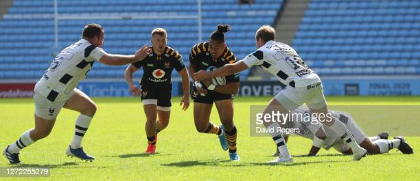 Marcus Watson of Wasps takes on Max Malins and Bryan Byrne during the Gallagher Premiership Rugby match between Wasps and Bristol Bears at the Ricoh...