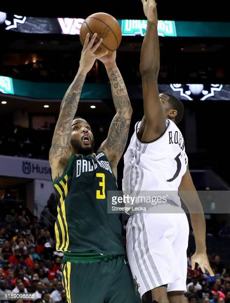 Marcus Williams of Ball Hogs shoots against Frank Robinson of Enemies during week two of the BIG3 three on three basketball league at Spectrum Center...