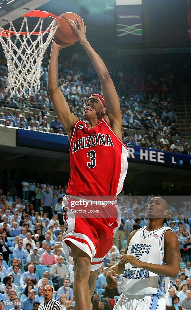 Marcus Williams #3 of the Arizona Wildcats dunks the ball as Reyshawn Terry #3 of the University of North Carolina Tar Heels watches on January 28, 2006 at the Dean E. Smith Center in Chapel Hill, North Carolina. The Tar Heels defeated the Wildcats 86-69.